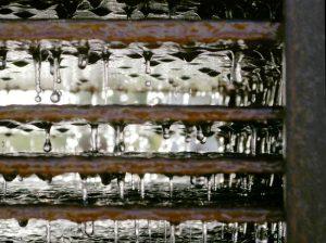 Water and corten steel in art